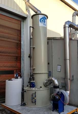 Scrubber for alkaline vapors